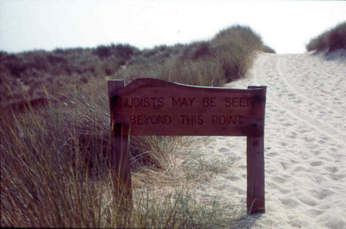 Naturists may be seen beyond this point