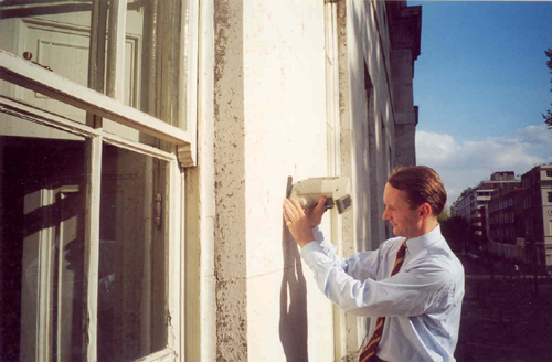 Patrick Baty measuring the colour of the Portland stone facade