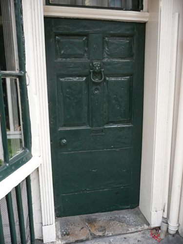 An 18th century door displaying many coats of paint