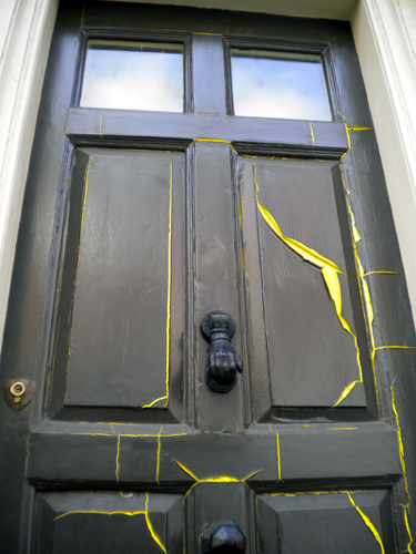 An example of what can happen if linseed oil paint is applied over a conventional gloss paint