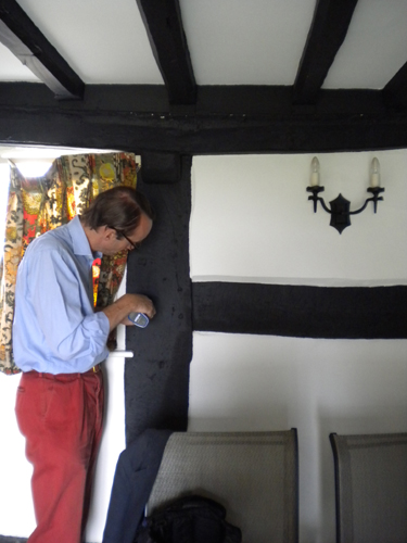 Patrick Baty taking a paint sample from this 17th century cottage