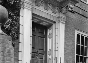 18th century doorcase, photograph by Nathaniel Lloyd (ca. 1915-1933). Reproduced by permission of National Monuments Record