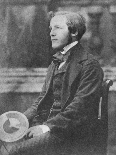 James Clerk Maxwell holding a Maxwell Disk